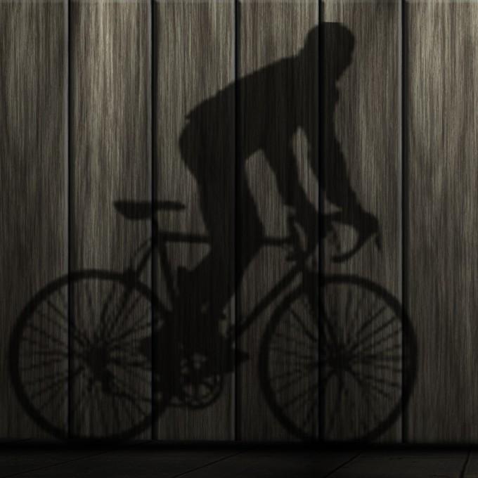 自転車乗っている人の影