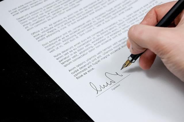 サインする